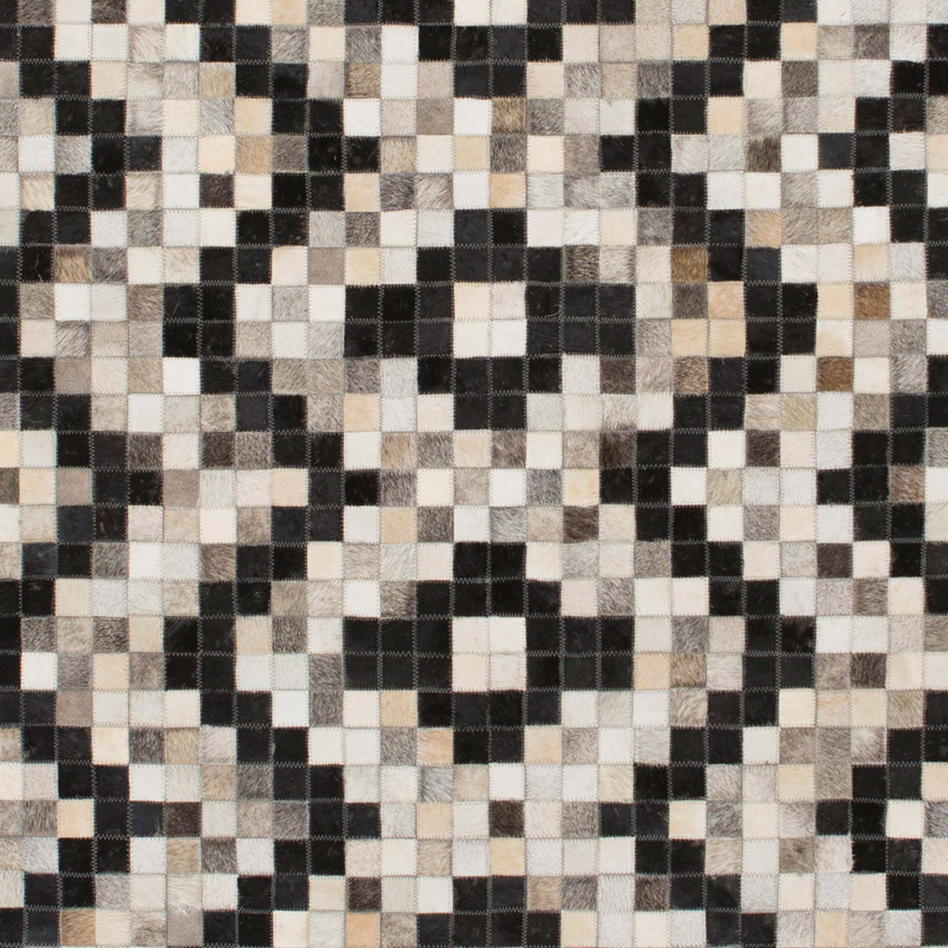 Handmade hair on hide rug from India with intricate black and gray pattern - Detail Shot