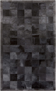 Handmade hair on hide area rug from India with black and metallic silver patchwork pattern