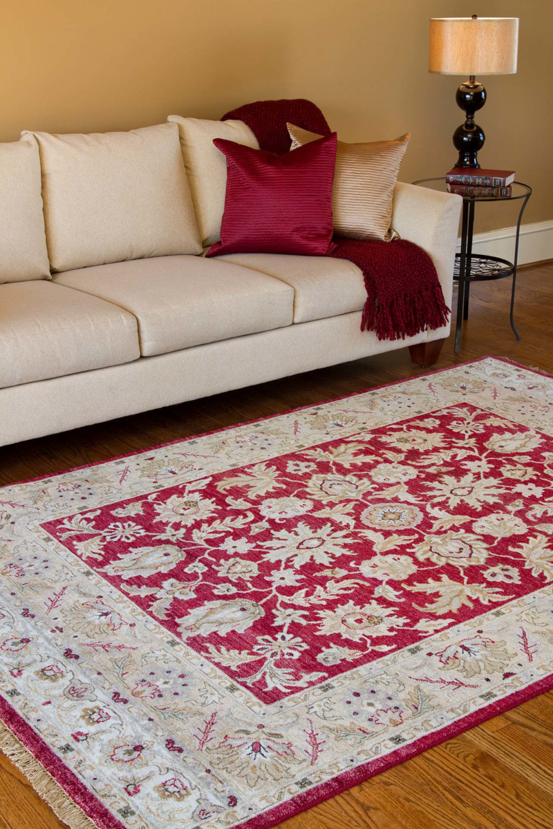 Hand knotted rug with hints of burgundy and khaki from the Surya Timeless Collection in Living Room