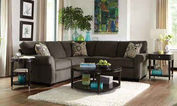 Broyhill handmade 2-piece roll arm sectional features loveseat & sofa with DuraCoil cushions perched with 2 toss pillows in a quality gray upholstery.