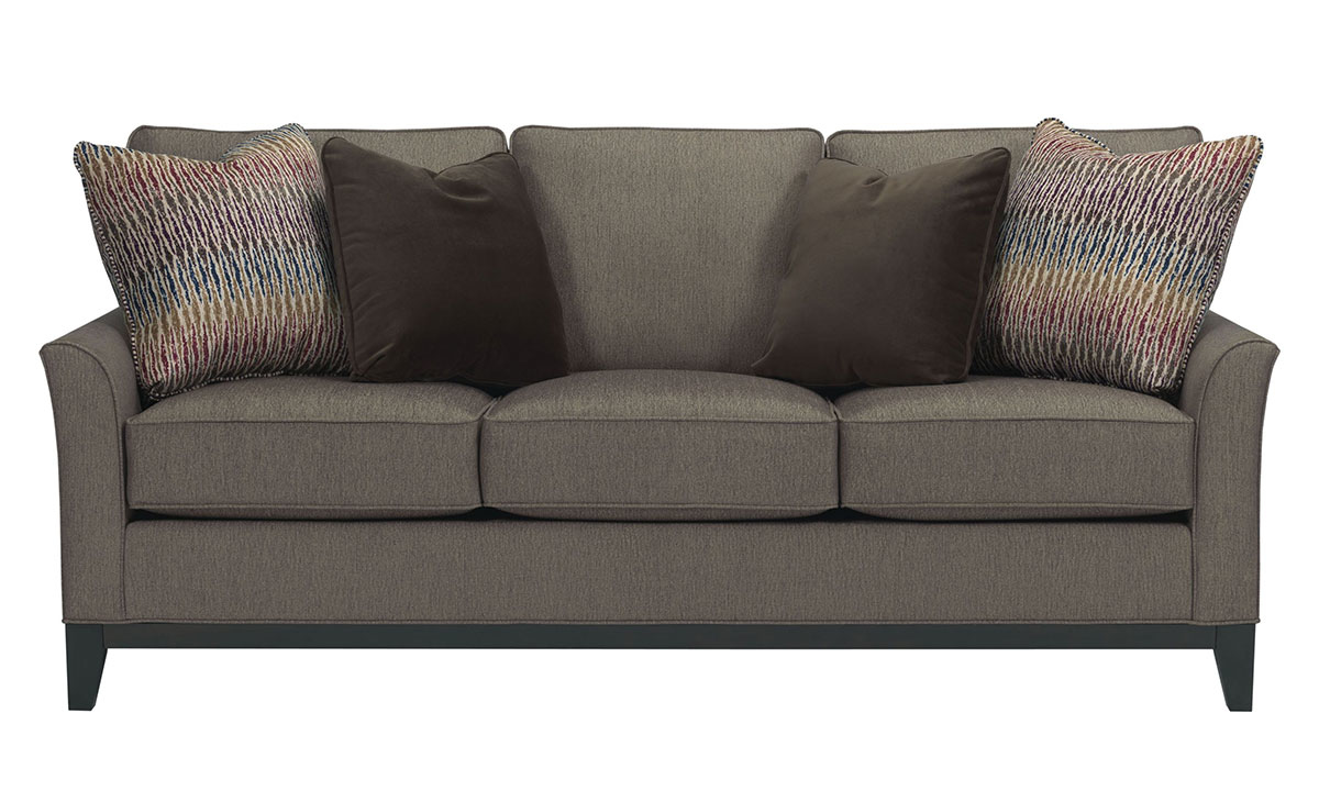 Broyhill handmade american sofa features durable hardwood framing with flare arm silhouette & 4 decorative toss pillows in a modern gray upholstery.