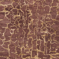Trendy hand-tufted area rug from India with brown and tan textured pattern- Close Up