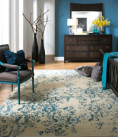 Trendy hand-tufted area rug from India with hints of blue and white from the Surya Banshee collection in Bedroom