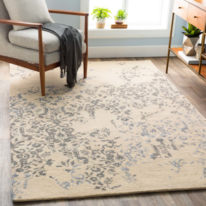 Trendy hand-tufted area rug from India with hints of blue and white from the Surya Banshee collection in Living Room