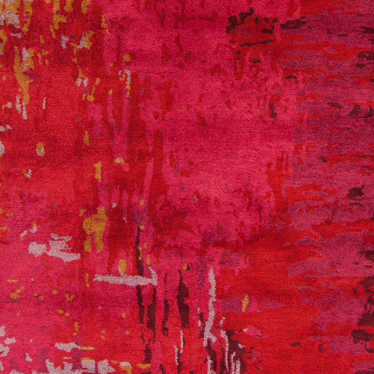 Contemporary hand-tufted area rug from India with splashes of red, pink and mustard - Small