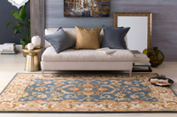 Classic hand-tufted area rug from India with cream, blue and red accents - Living Room Shot