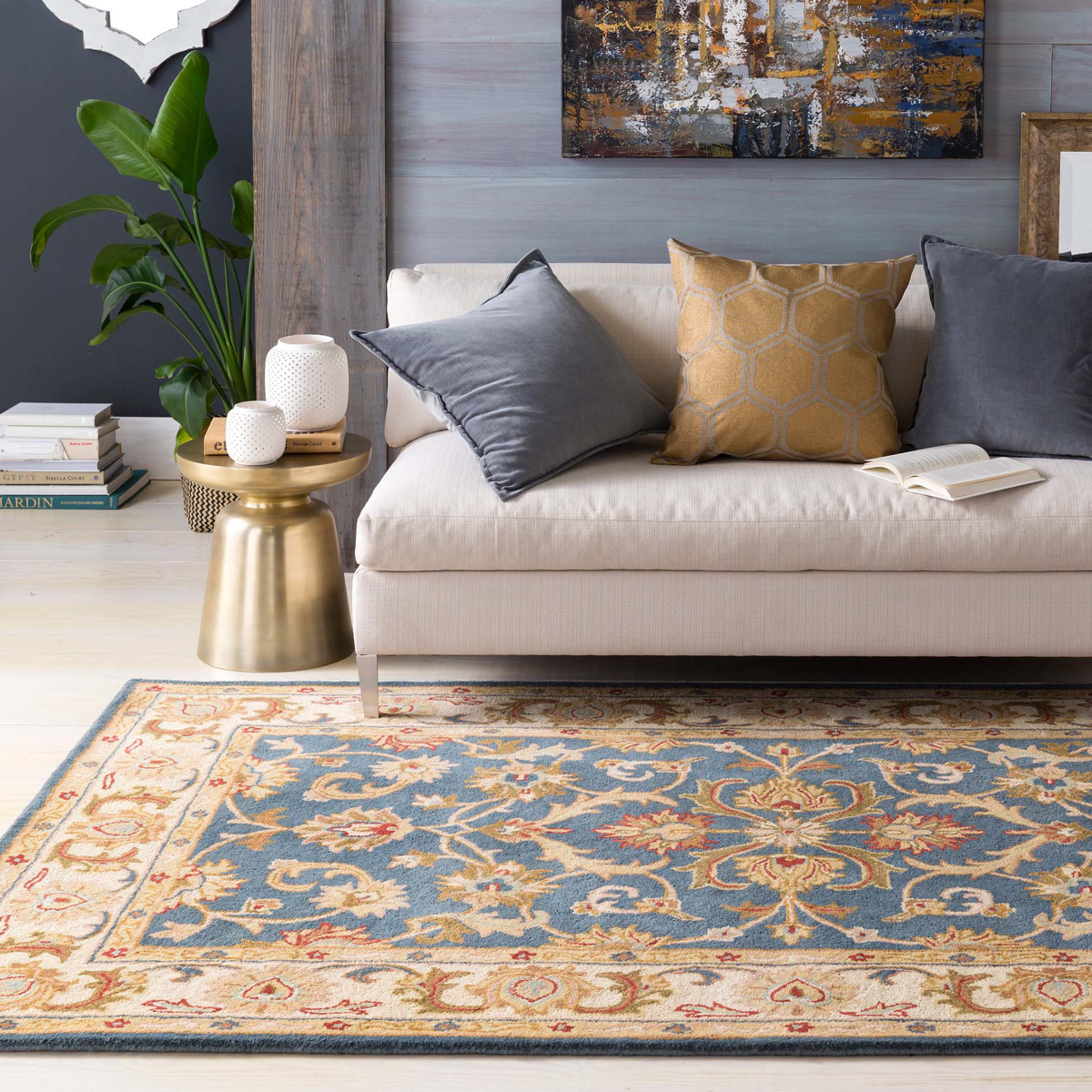 Classic hand-tufted area rug from India with cream, blue and red accents - Living Room ShotClose