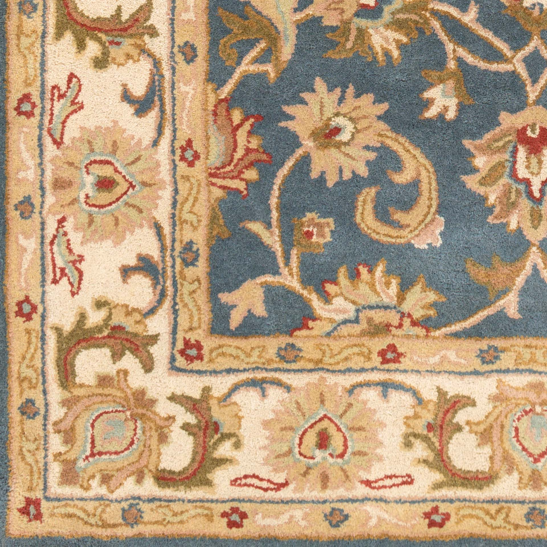 Classic hand-tufted area rug from India with cream, blue and red accents - Pattern Detail
