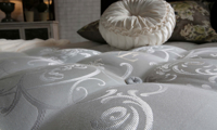 Luxury closeout king mattress handcrafted from Yorkshire wool with 5000 coils from Spink & Edgar - Closeup shot of cover