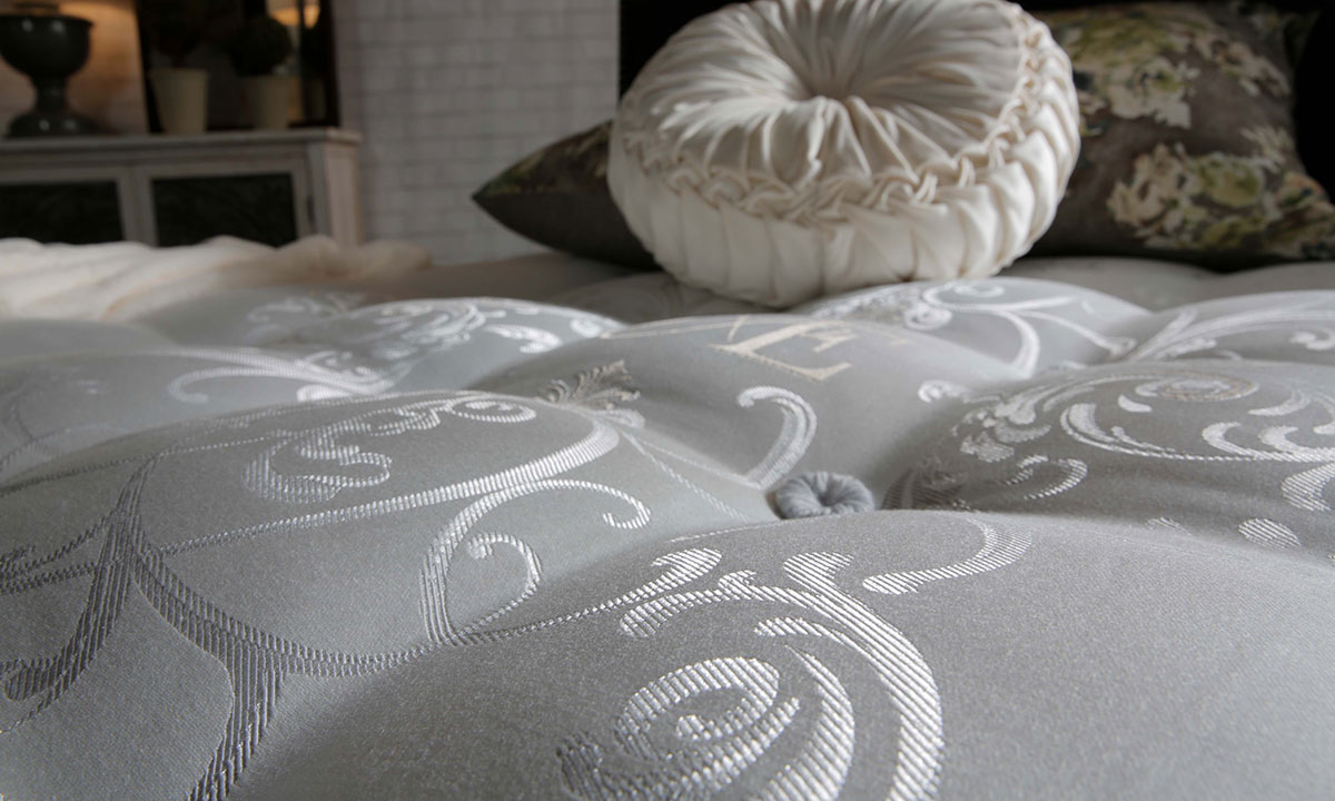 """Luxury 12"""" king mattress handcrafted in England from alpaca wool with over 7000 coils - Closeup cover shot"""