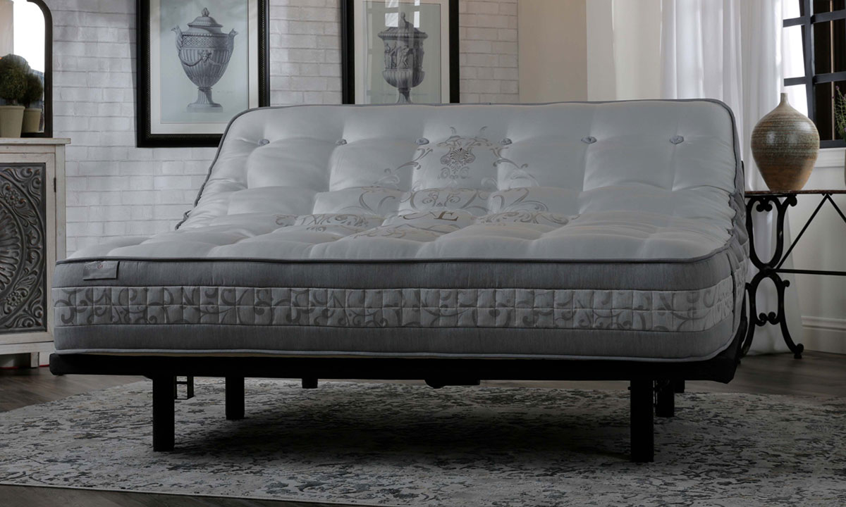 """Luxury 14"""" queen mattress handcrafted in England from cashmere with over 17000 coils on adjustable base in bedroom"""