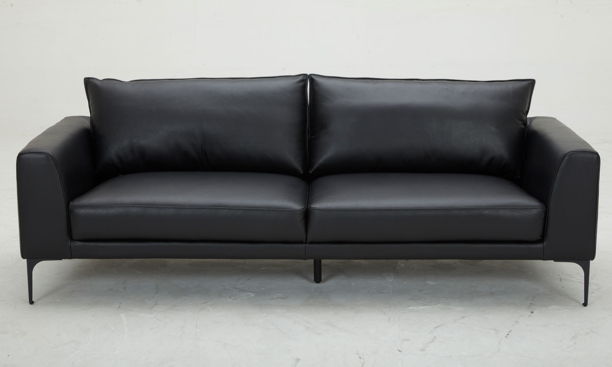 Modern and sleek pillowback sofa in black top-grain leather with vinyl match atop metal legs - Front  View
