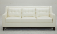 Mid-century modern sofa with button tufting in white leather - front view