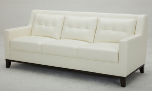 Mid-century modern sofa with button tufting in white leather - angled view