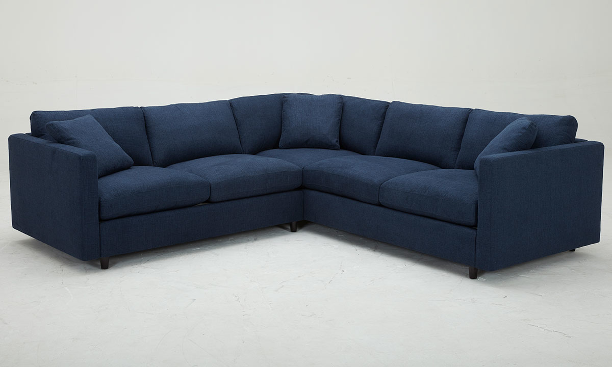 Family size sectional sofa with feather down cushions in navy upholstery - Front View