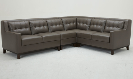 Mid-century grey sectional sofa with button tufting in grey leather with vinyl match - Front View