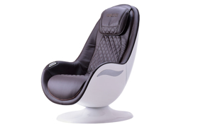 Modern massage chair in brown with quilting in white shell - Angled View