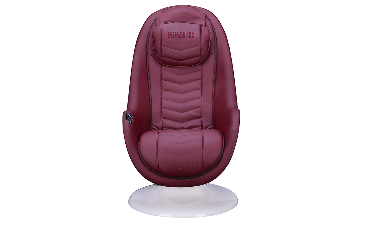Modern massage chair with quilted red upholstery in white shell - Front View