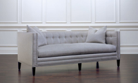 Classic tuxedo sofa in grey herringbone upholstery with nailhead trim and button tufting