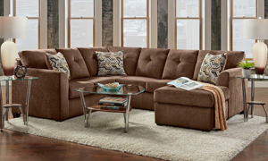 2-piece sectional sofa in chocolate brown upholstery with loose pillow-back cushions and toss pillows