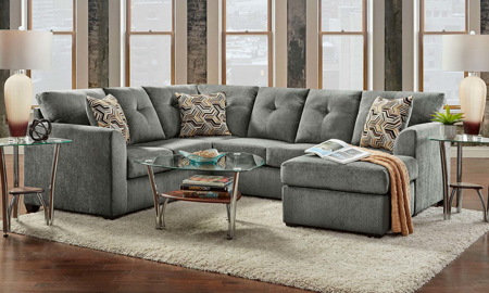 American-made 2-piece sectional with loose pillow-back cushions in grey upholstery with toss pillows.