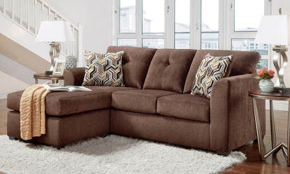 Sofa with chaise and button tufting and loose pillow-back cushions in chocolate brown upholstery.