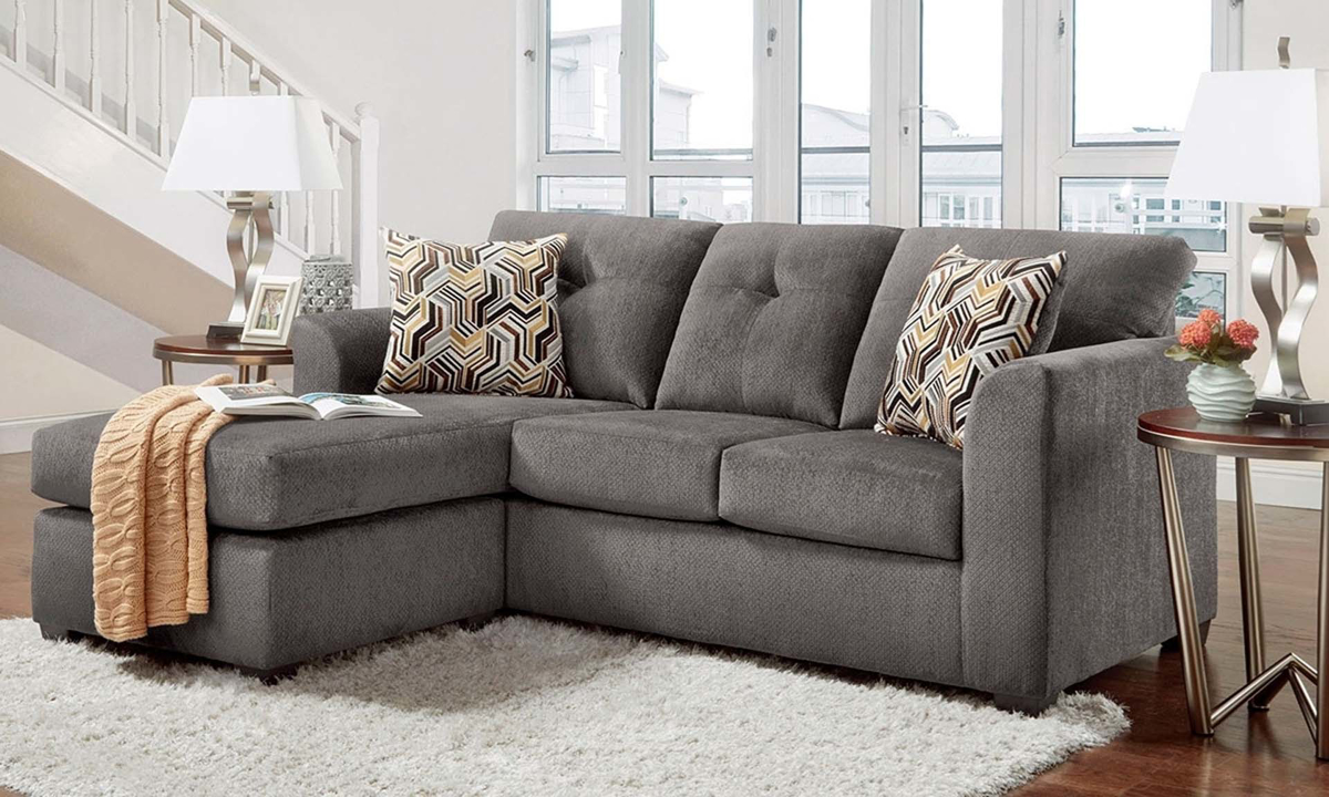 American-made sofa with chaise in gray chenille upholstery with loose pillow-back cushions.