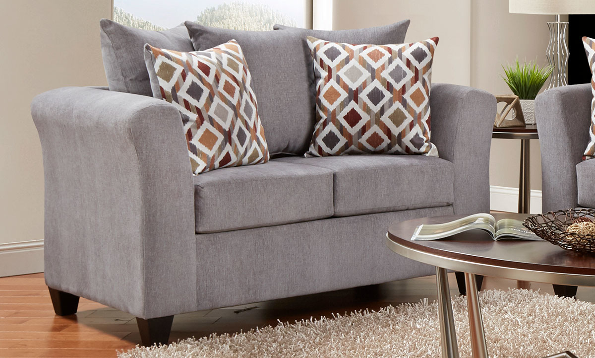 Casual 66-inch pillow-back loveseat with loose pillow-back cushions in gray upholstery with track arms and toss pillows.