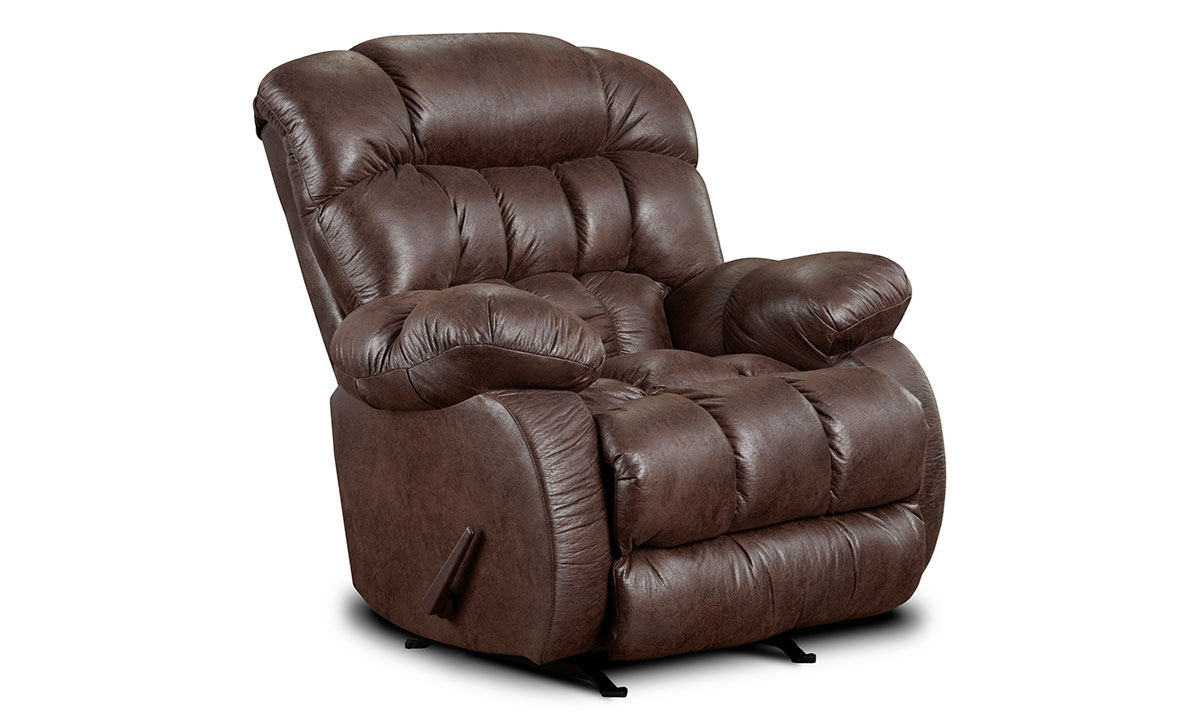 Overstuffed triple pillow back rocker with manual recliner in chocolate brown upholstery.