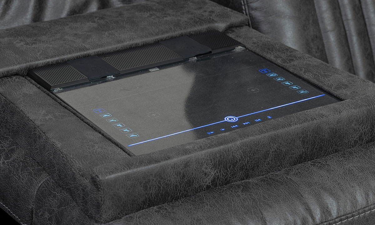 Closeup of touch screen controls on power theater sofa in charcoal gray upholstery