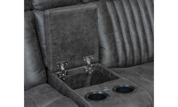 Closeup of hidden storage and cupholders on power theater loveseat with recliner in charcoal gray upholstery