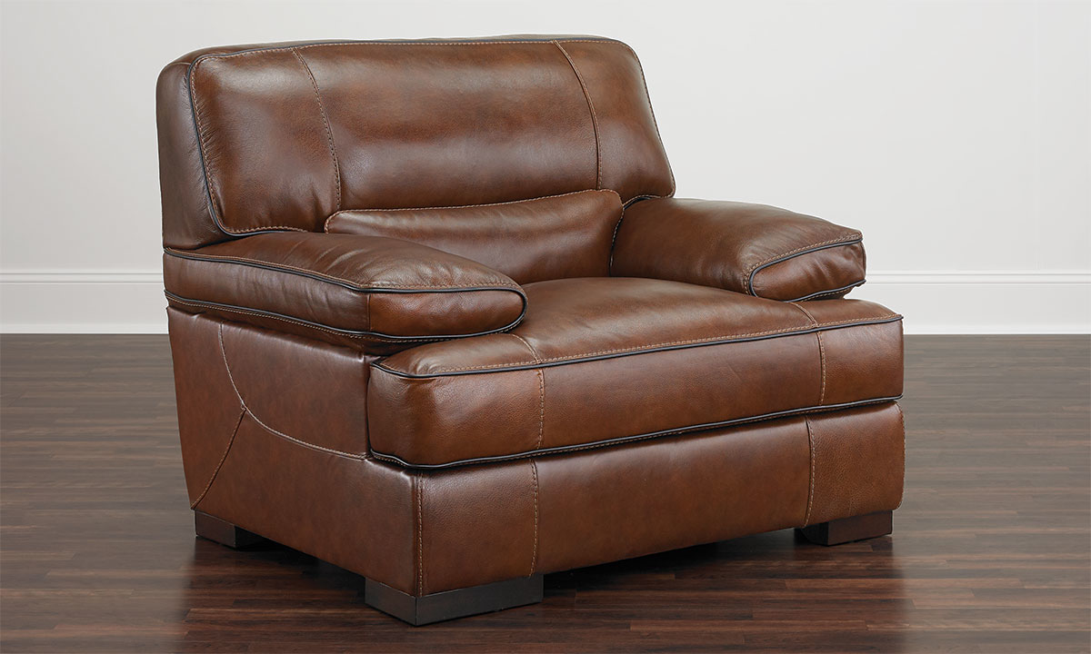 Contemporary armchair with plush arms and feather down cushions in brown top-grain leather