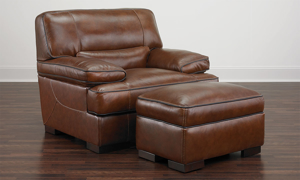 """Contemporary 31"""" plush ottoman in brown top-grain leather atop wooden feet"""