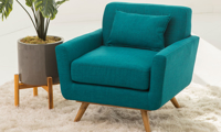 Retro and modern button tufted arm chair in teal linen-like upholstery with flared legs and matching pillow