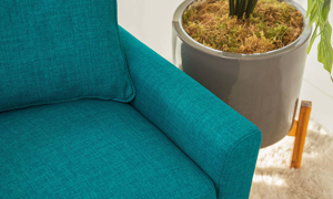 Close-up of track arm on mid-century modern sofa in teal upholstery