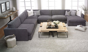 American-made sectional with right chaise and 44-inch deep seating in charcoal gray upholstery.