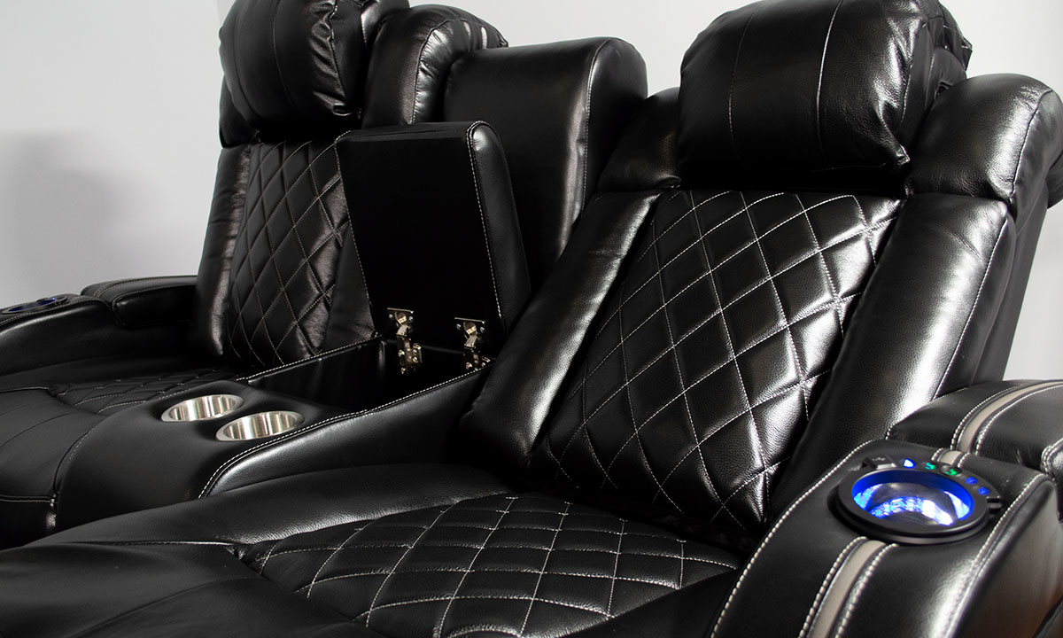 Close-up of Transformer theater sofa with blue LED lights and power recline in black top grain leather