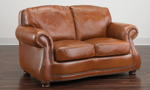 American-made 66-inch loveseat in top-grain cognac leather with nailhead trim
