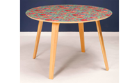 """Modern 51"""" round dining table with green, pink and purple floral design and 4 wooden legs."""