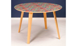 "Modern 51"" round dining table with green, pink and purple floral design and 4 wooden legs."