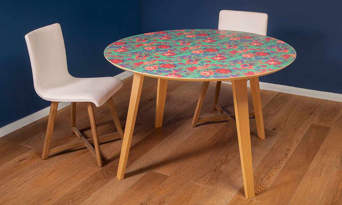 "Modern 51"" round dining table with green, pink and purple floral design and 4 wooden legs and chairs"
