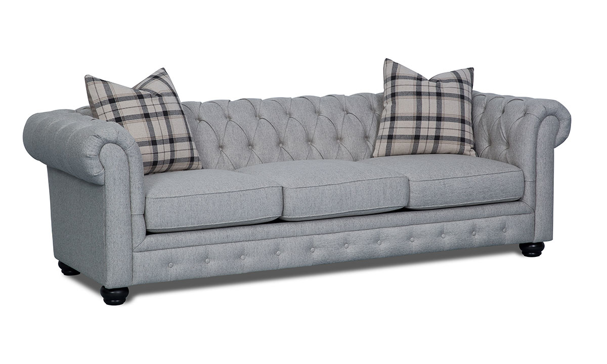 98-inch Chesterfield sofa in grey upholstery with button tufted back and roll arms - Angled Shot