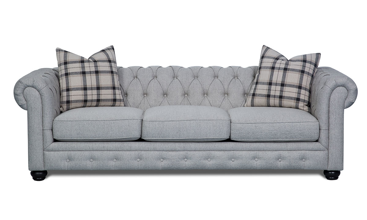 98-inch Chesterfield sofa with button tufting and rolled arms in stone grey upholstery and toss pillows