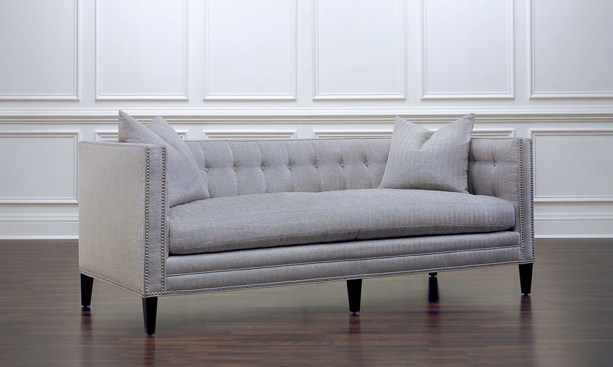 Tuxedo sofa with silver nailhead trim, button tufting and wood legs in grey herringbone upholstery