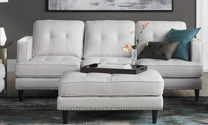 Mid-century modern tufted sofa with nail head trim in white linen-look upholstery