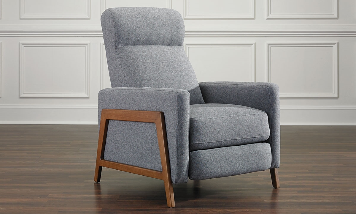Modern accent chair with pushback recliner in soft gray upholstery with exposed wood frame.