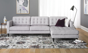 Contemporary Biscuit-Tufted Sofa with Over-sized 6 ft Chaise in Light Grey Upholstery in Family Room