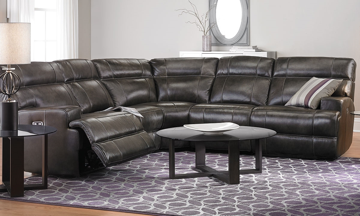 Power reclining sectional with power headrest and USB ports in brown top-grain leather