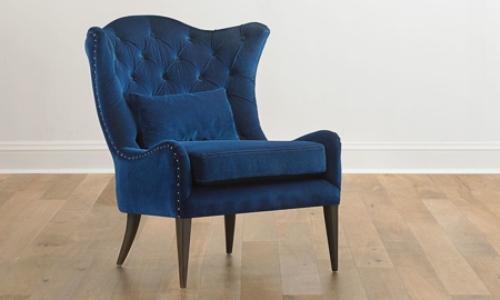 Elegant navy blue velvet wingback chair with button tufts and nailhead trim