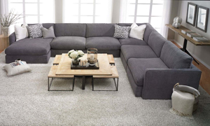 Contemporary sectional sofa with 44-inch deep seating with down feather seating with left facing chaise in charcoal gray upholstery